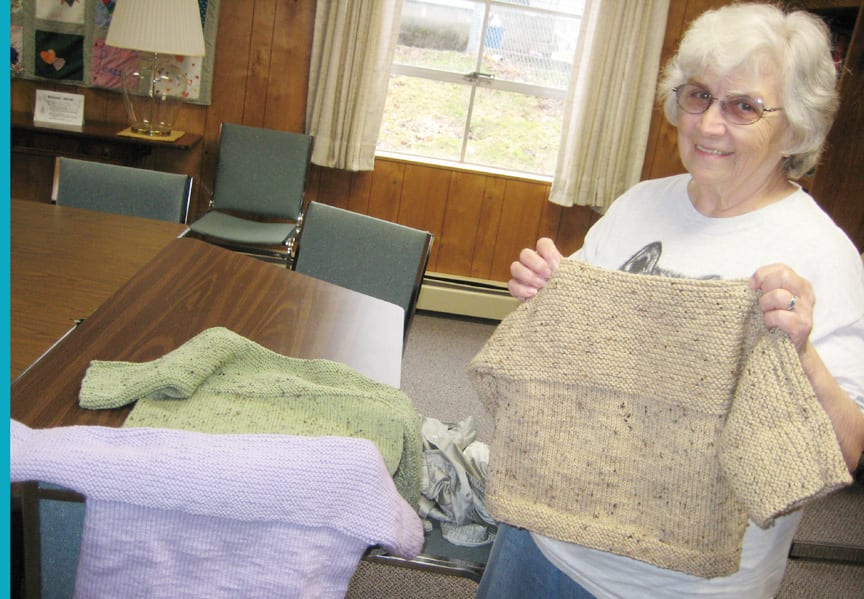 Local woman knits sweaters for international program