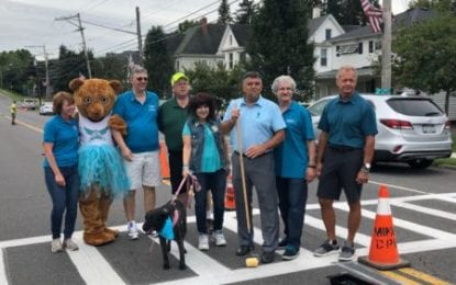 Painting the village teal: Minoa paints teal stripe on Main Street for Ovarian Cancer Awareness Month
