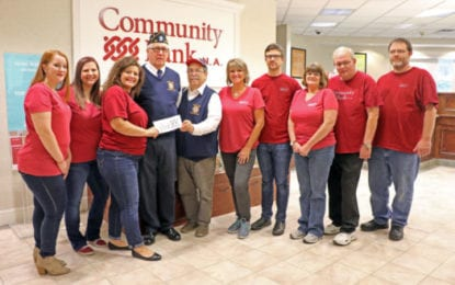 Community Bank N.A. washes store windows, donates to charity