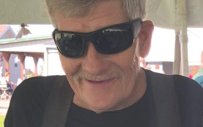 John E. Oursler, 65