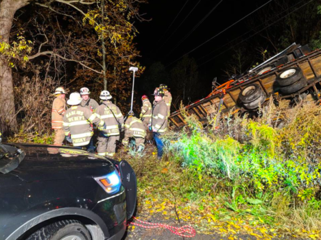 Dump truck, tractor-trailer slide down embankment in Manlius