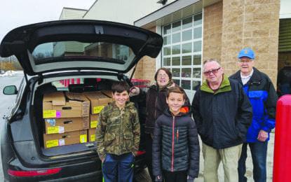 Rotarian make holiday donation